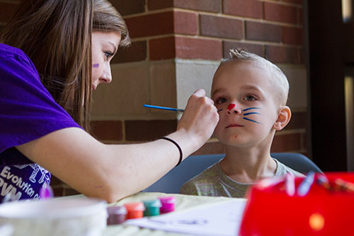 A young Open House Visitor stops by the face painting booth at the 2016 PVM Open House.
