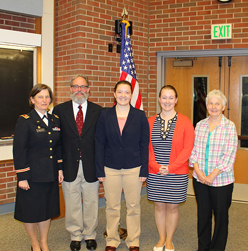 First-year Purdue veterinary student Megan Swasey (center) with her family, including her mom, Lieutenant Colonel Kim Swasey (left), at her commissioning ceremony in Lynn 1136 Friday, May 5.