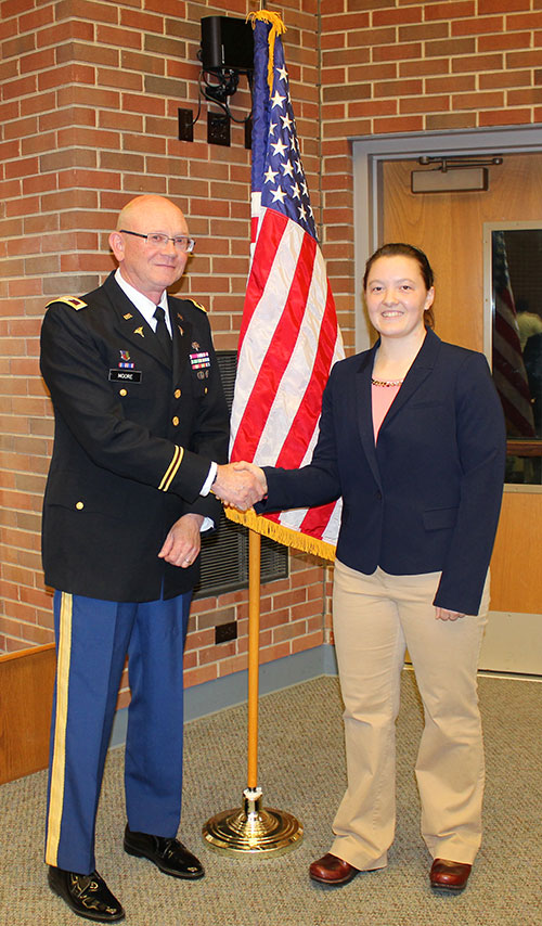Megan Swasey with U.S Army Colonel George Moore, PVM professor of clinical epidemiology and director of clinical trials, who administered the oath of office at the commissioning ceremony.