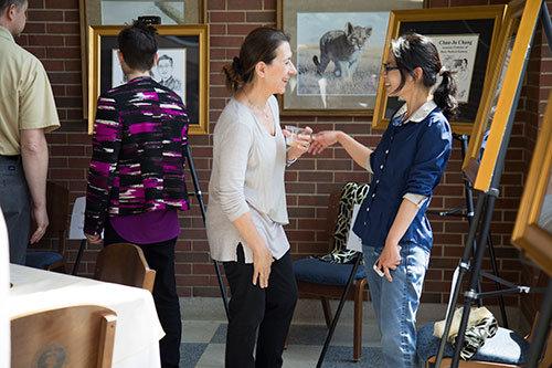 Professor Ourania Andrisani chats with fellow Basic Medical Sciences Department faculty member Chun-Ju (Alice) Chang, who was honored at the reception in celebration of her promotion to associate professor.