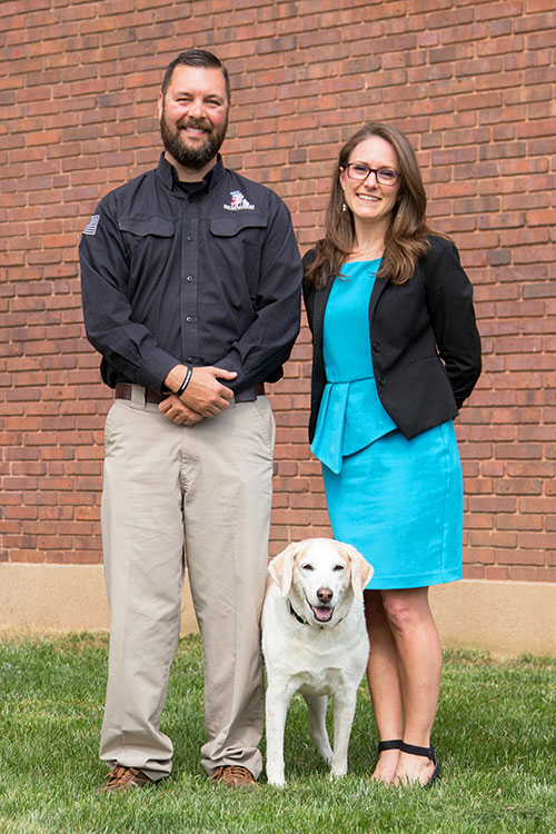 Dr. Maggie O'Haire, assistant professor of human-animal interaction in the Department of Comparative Oncology, with her dog, Chloe, and Jason Snodgrass, chief operating officer of K9s For Warriors, which is partnering with Dr. O'Haire on a study of the effects of service dogs on veterans with PTSD.