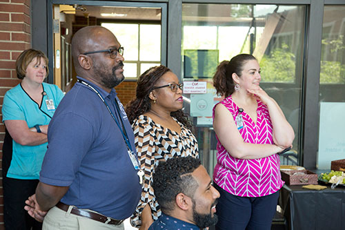 Dr. Darryl Ragland (2nd from left) watches as the A<sup>2</sup>RC students are honored at the Farewell Reception. He is joined by Dr. Kauline Cipriani, director of diversity and inclusion; Marisol Uribe, diversity and inclusion administrative assistant; (seated) Will Smith, II, director of international programs; and (back) Jennifer Ashley, RVT, senior instructional technologist in the Veterinary Teaching Hospital.