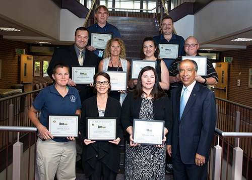 Dean Willie Reed with PVM Bravo Award recipients: (front row, left-right) Crystal Hagan, Cassandra Simmons and Adrianne Fisch; (middle row) Bill Kielhorn, Jan Goetz, Marisol Uribe and Nicholas O'Neill; (back row) Steve Vollmer and Jason Lee.