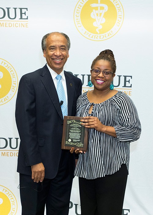 Outstanding Staff Award recipient Kauline Cipriani with Dean Willie Reed.