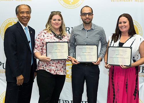 Dean Willie Reed congratulates staff members who completed the Online Certificate Program for Diversity and Inclusion in Veterinary Medicine (left-right): Lauren Bruce, Juan Zamora-Moran and Amanda Weaver.