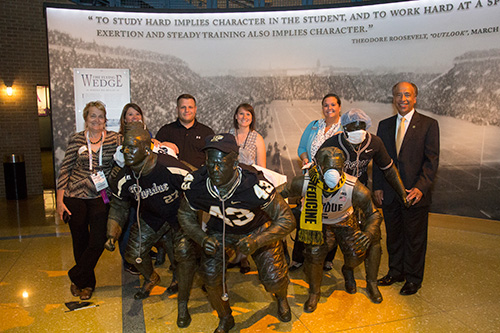 Dean Willie Reed and several PVM alumni pause for a photo-op at a sculpture depicting college football players, who were bedecked in a combination of Purdue and veterinary medical gear for the Purdue Alumni Reception at the NCAA Hall of Champions in Indianapolis.