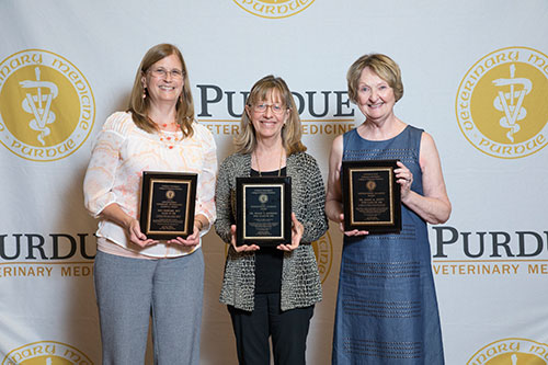 The 2017 awards for Purdue Veterinary Medicine distinguished alumni were presented to (left-right) Kay Stewart, RVT, Dr. Susan Johnson and Marilyn Scott, who accepted the posthumous award on behalf of her late husband, Dr. James Scott.