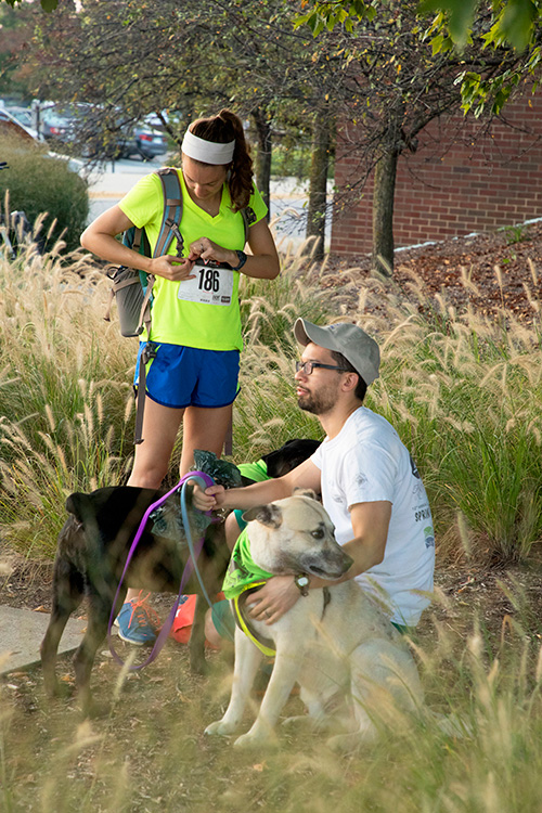 Participants and their canine companions gear up outside Lynn Hall for the 2017 Dr. Skip Jackson Dog Jog, Saturday, September 23.