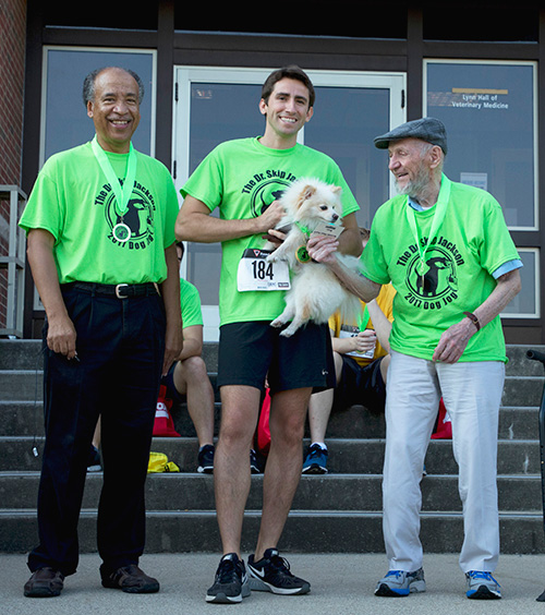 "The award for having the ""Cutest Dog"" at the Dog Jog was presented to participant John Wagner."