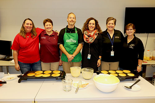Pancake (left-right)  breakfast volunteers Julie Roahrig, RVT; Pam Phegley, BS, RVT; Josh Clark, MS, RVT; Dr. Bianca Zenor, Veterinary Technology Program director; Paige Allen, MS, RVT and Martie Knill, Veterinary Technology Program secretary, serve-up flapjacks during the Veterinary Technology Program's celebration of National Vet Tech Week.