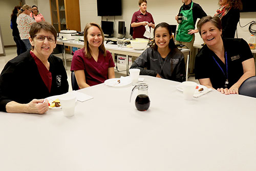Pancake Breakfast attendees (left-right) Kris Kazmierczak, Olivia Wyatt, and Christa Crain hang out with breakfast volunteer Paige Allen.
