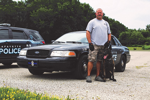 Officer Ryan French poses with Roy, a five-year-old veteran of the unit, which includes the Lafayette, West Lafayette and Purdue Police Departments, and the Tippecanoe County Sheriff's Department. This group trains and works together, deploying resources throughout the metro area.
