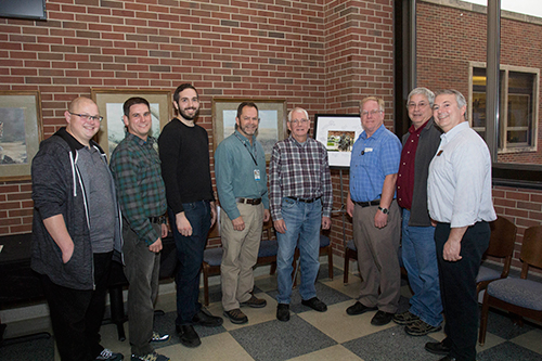 (Left-Right) Nick O'Neill, Eric Biggs, Bob Yates, Ron Johnson, Tom Carnahan, and Dave Chasey with two of Tom's former supervisors, Bruce Bresnahan (Psychological Sciences), and Brian Berndt (currently with IT Customer Relations and Process Management) at the reception in honor of Tom's retirement December 18 in Lynn Hall.