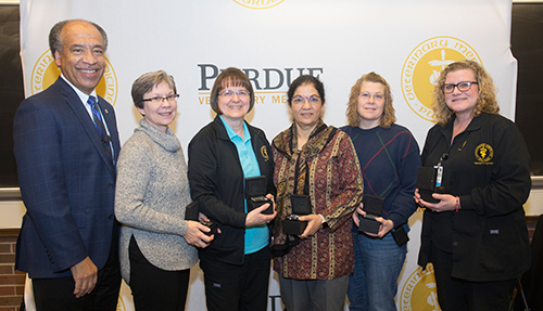 Dean Willie Reed recognizes PVM staff members who completed 20 years of service to Purdue University: (left-right) Debra Branham (VTH), Carol Caldwell (VTH), Margaret Gehlhausen (ADDL), Lisa Holeman (CPB) and Stephanie Stillwell (VTH). (Not pictured: Renu Bajaj, ADDL).