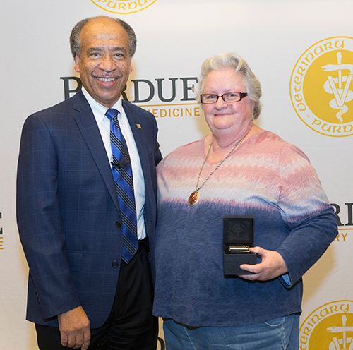 Bonita Vera (ADDL) is congratulated for 30 years of service to Purdue.