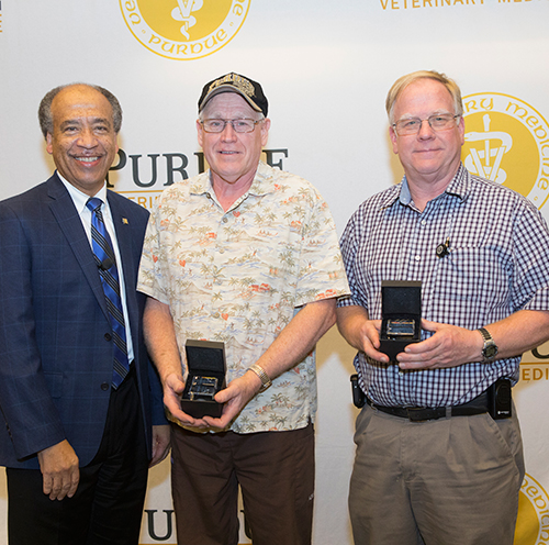 Dean Willie Reed with (center) Robert White (ADDL) and Dave Chasey (VAD), who both were recognized for 35 years of service to Purdue (not pictured: Donna Schrader, ADDL).