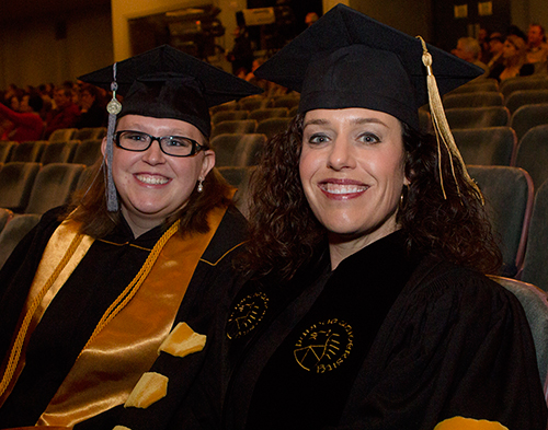 New Purdue BS-VT graduate Jennifer Hartman and Veterinary Technology Program Director Bianca Zenor await the start of the Winter Commencement Ceremony in the Elliott Hall of Music.