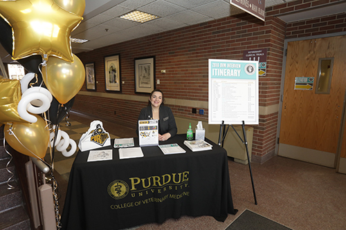 Marisol Uribe, administrative assistant for the Office for Diversity and Inclusion, hosts a welcome table on the ground floor east entrance to Lynn Hall.