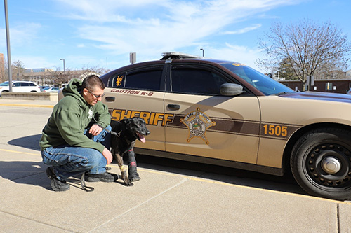 Deputy Doug Parker of the Lake County Indiana Sherriff's Department with Rocky, a six-year veteran K9 officer that was injured in an interstate car chase in Northwest Indiana. Rocky was brought by helicopter to Purdue University, where he received emergency treatment at the VTH for a broken bone in his left paw.