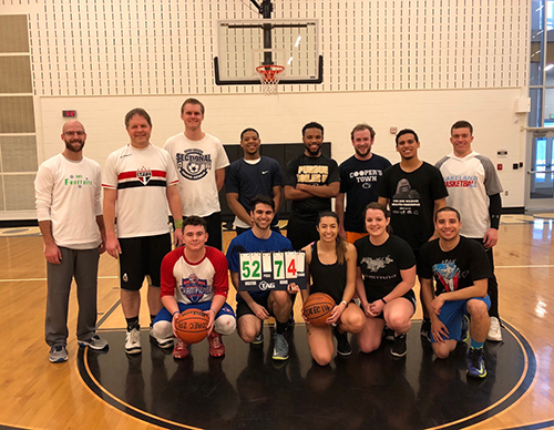 Members of the PVM faculty/staff team join students from the DVM classes of 2018 and 2019 for a group photo at the Purdue SAVMA Basketball Contest.