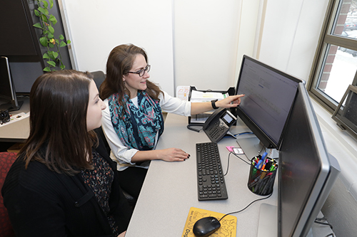 Dr. Maggie O'Haire reviews research information with study co-author Kerri Rodriguez, who is part of the Organization for Human-Animal Interaction Research and Education (OHAIRE) research group at Purdue University.