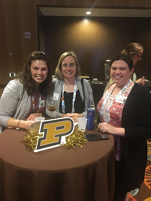 Purdue Veterinary Medicine alumni (left-right) Michelle Temple (AS-VT 2014), Lisa Nichols (AS-VT 1996) and Michelle Hendrickson (DVM 2012) visit at the Purdue Alumni Reception held February 6 in Orlando during the VMX Veterinary Meeting and Expo (formerly NAVC).